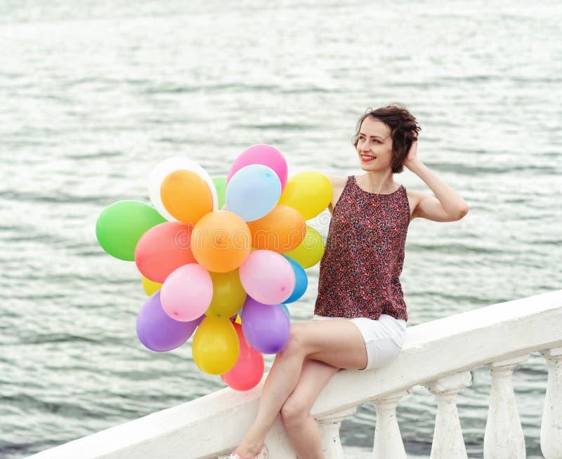 Fille avec des ballons images stock