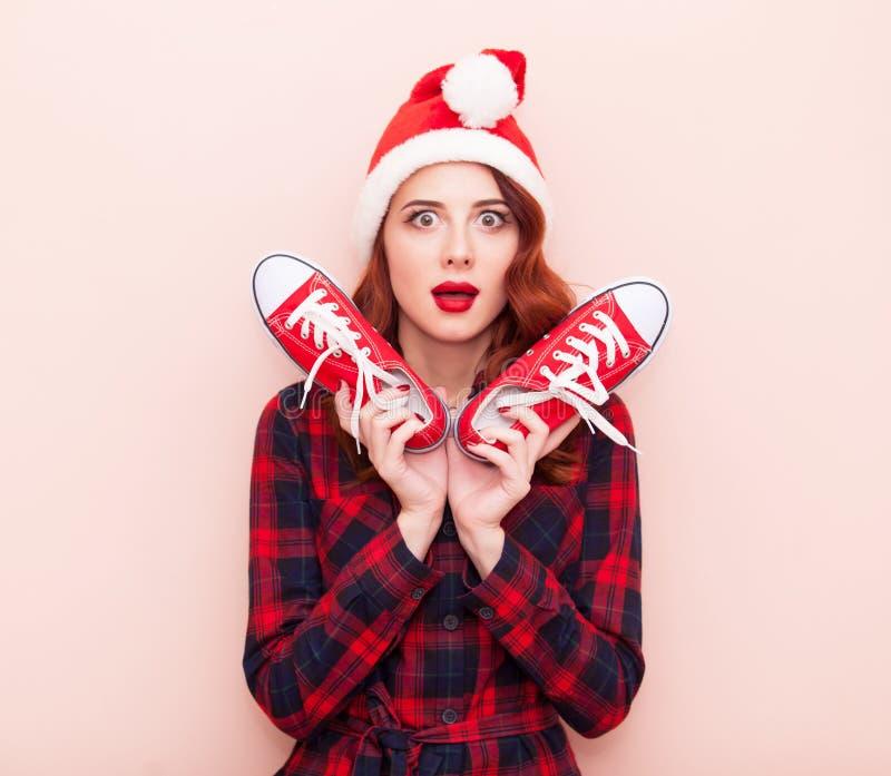 fille avec des chaussures en caoutchouc image stock
