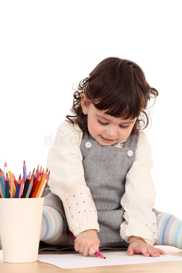 Fille avec des crayons photo stock