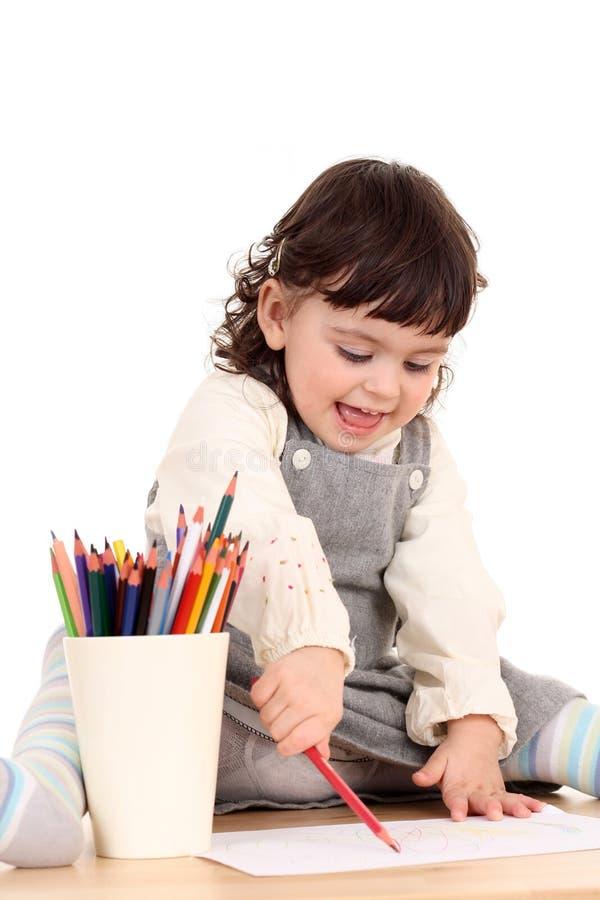 Fille avec des crayons image libre de droits