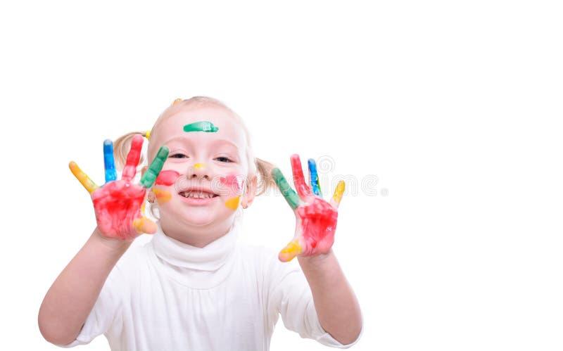 Fille avec des mains dans la peinture photographie stock