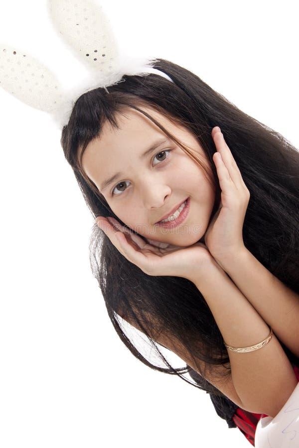 Fille avec des oreilles de lapins image libre de droits