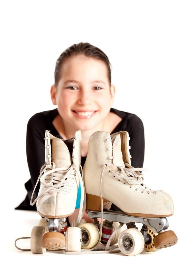 Fille avec des patins de rouleau photographie stock