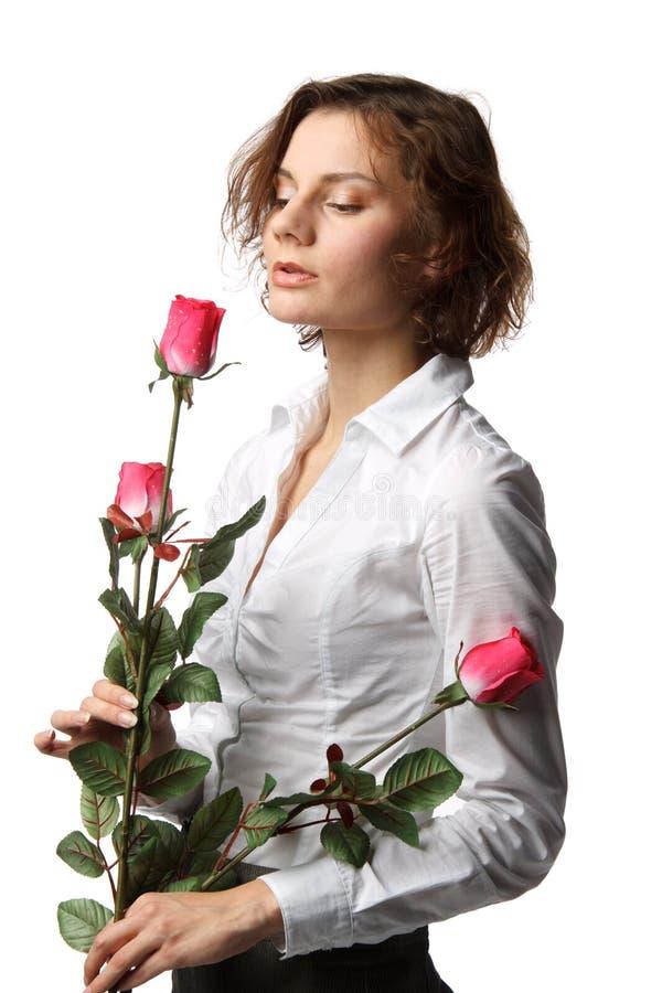 Fille avec des roses photographie stock