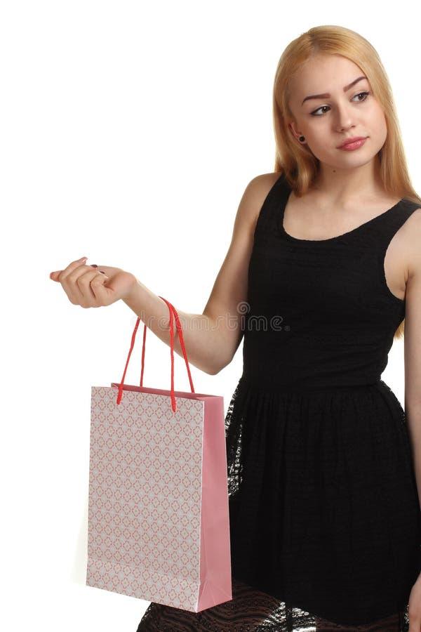 Fille avec des sacs à provisions - sally images stock