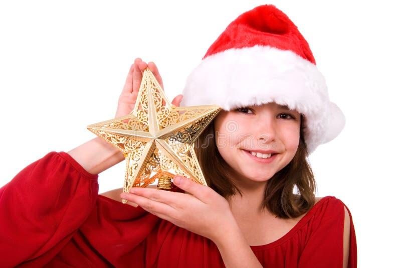 Fille avec l'étoile de Noël. photos libres de droits