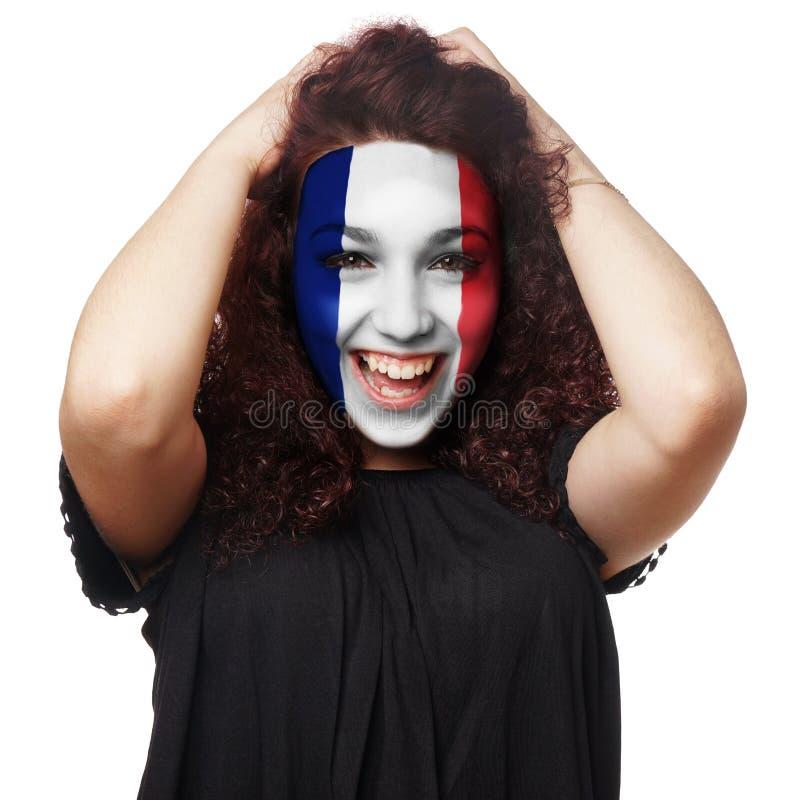 Fille avec la peinture française de visage de drapeau images libres de droits