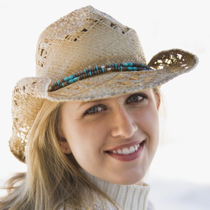 Fille avec le chapeau de cowboy. photographie stock libre de droits