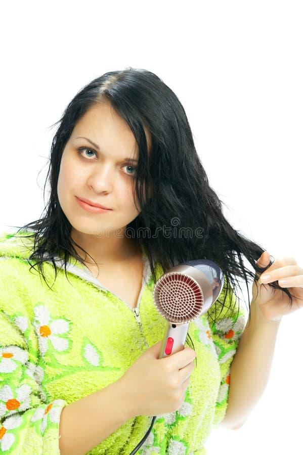 Fille avec le cheveu-dessiccateur photos libres de droits