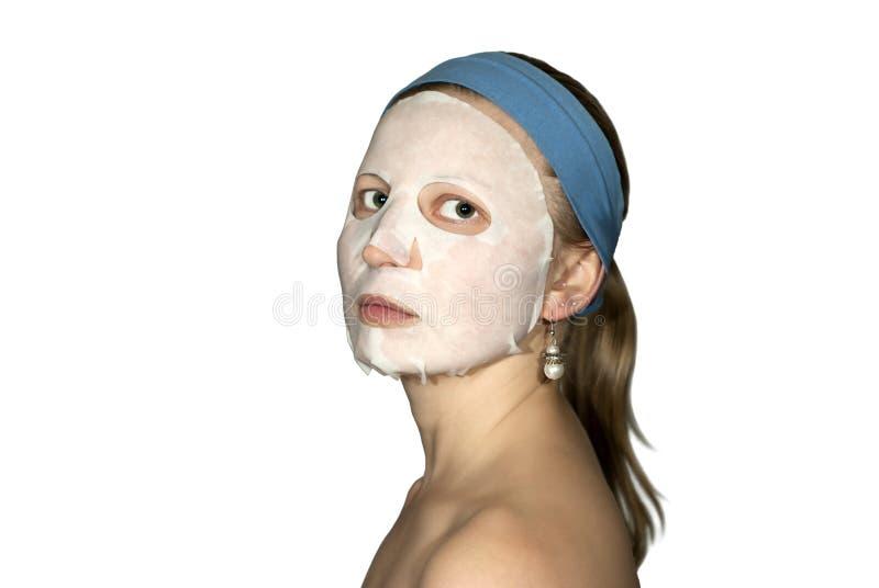 Fille avec le masque de papier facial photo libre de droits