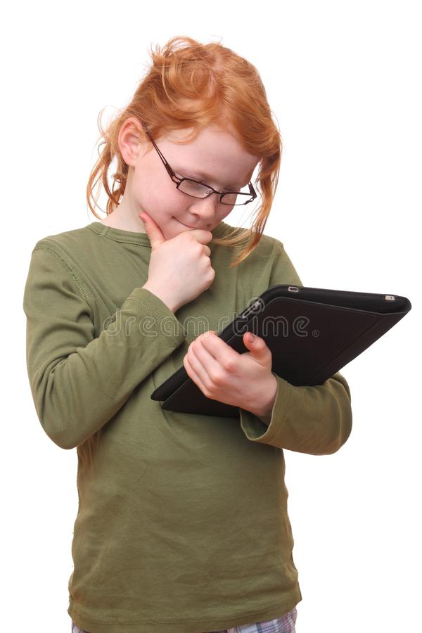 Fille avec le PC de tablette photographie stock