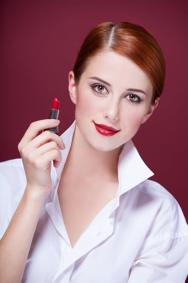 Fille avec le rouge à lèvres photo libre de droits