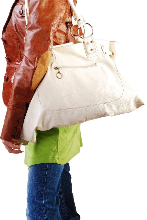 Fille avec le sac à main en cuir images stock