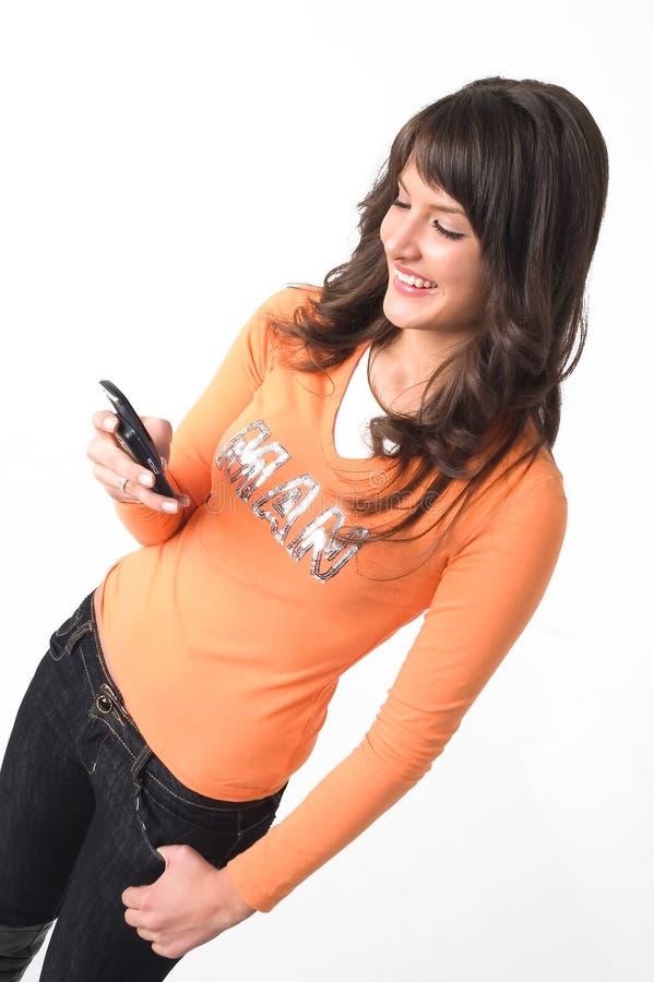 Fille avec le téléphone portable images stock