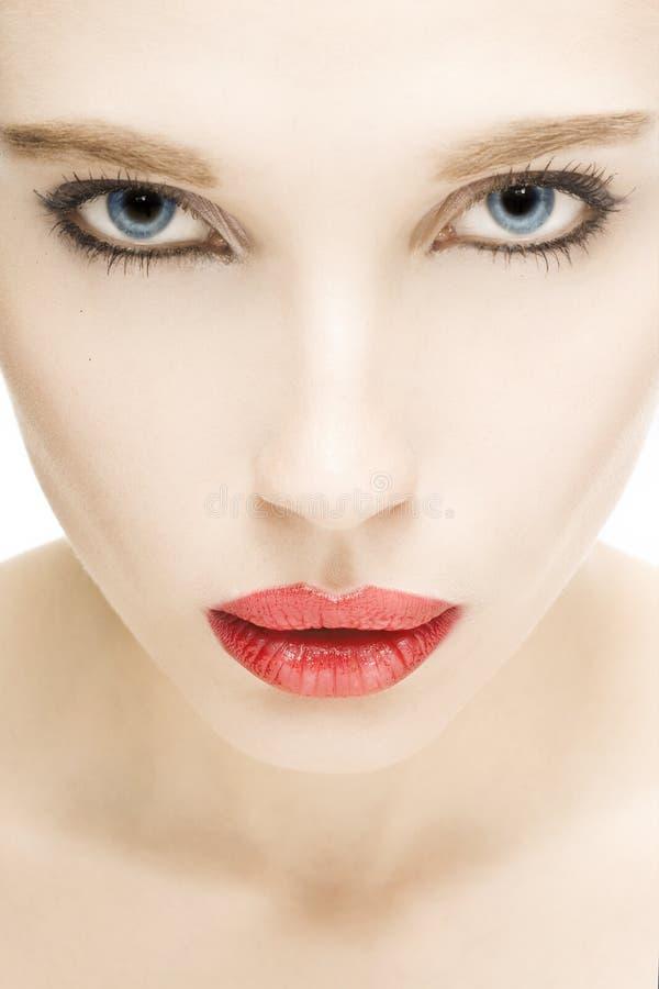Fille avec les languettes rouges image stock