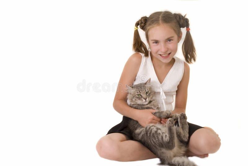 Fille avec un chat III image stock