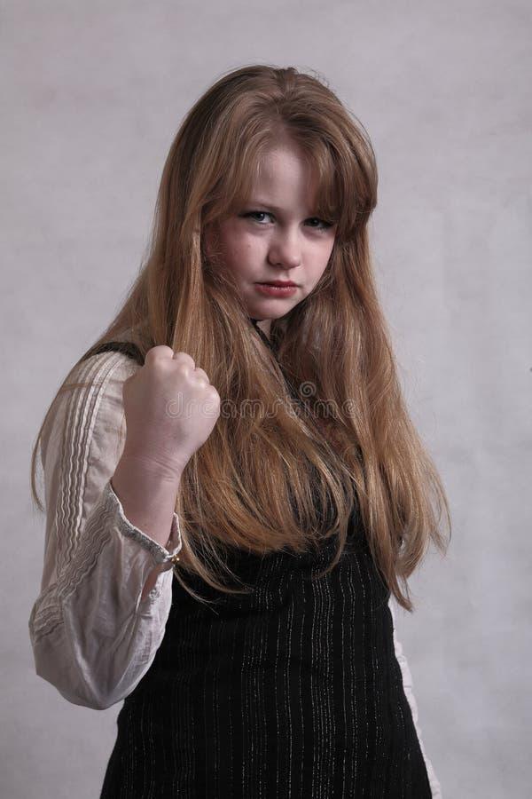 Fille blonde de l'adolescence fâchée images libres de droits