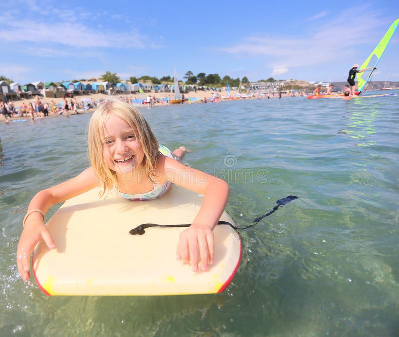Fille Bodyboarding images stock