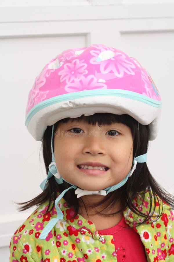 Fille chinoise asiatique d'enfant avec le casque images libres de droits