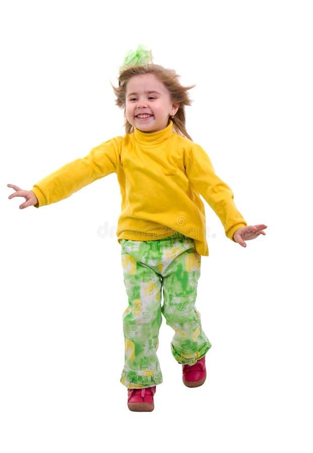Fille courante d'enfant. photographie stock