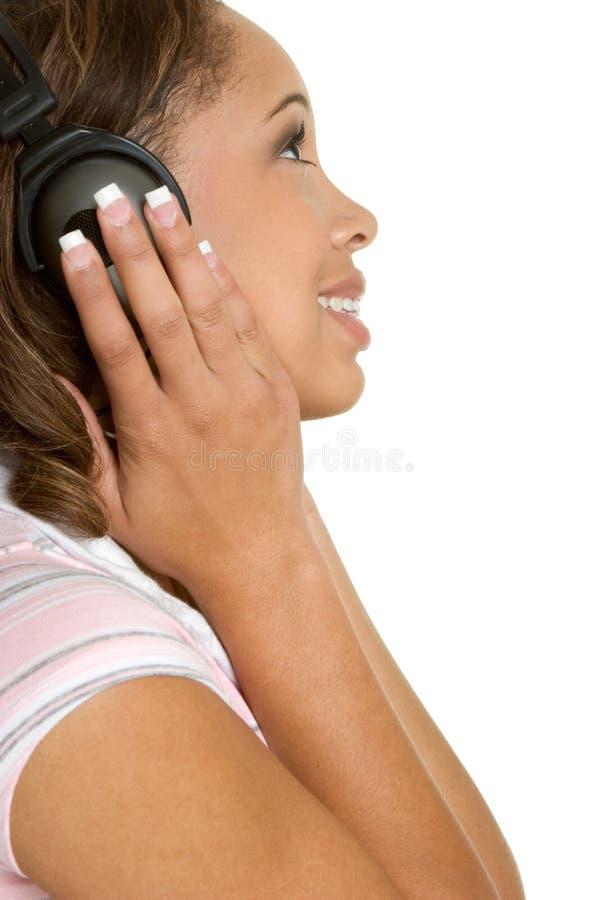 Fille d'écouteurs images stock