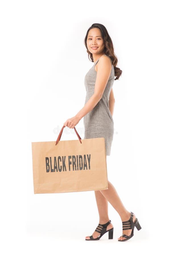 Fille d'achats de Black Friday photographie stock