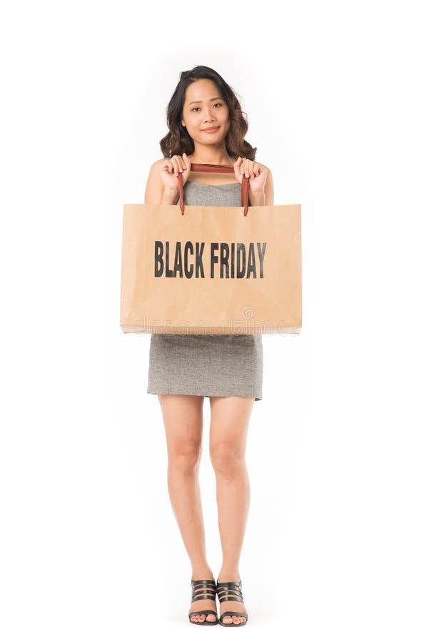 Fille d'achats de Black Friday photos libres de droits