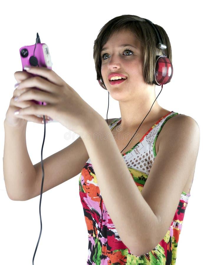 Fille d'adolescent écoutant la musique photo libre de droits