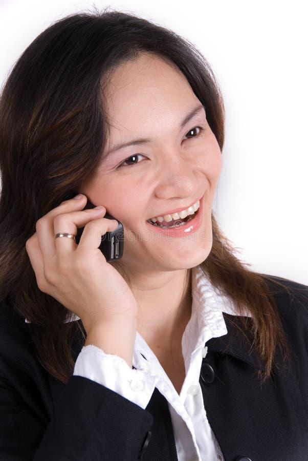 Fille d'affaires au téléphone photo stock