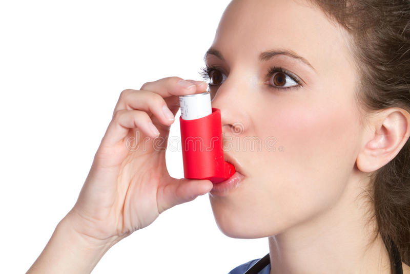 Fille d'inhalateur d'asthme image libre de droits