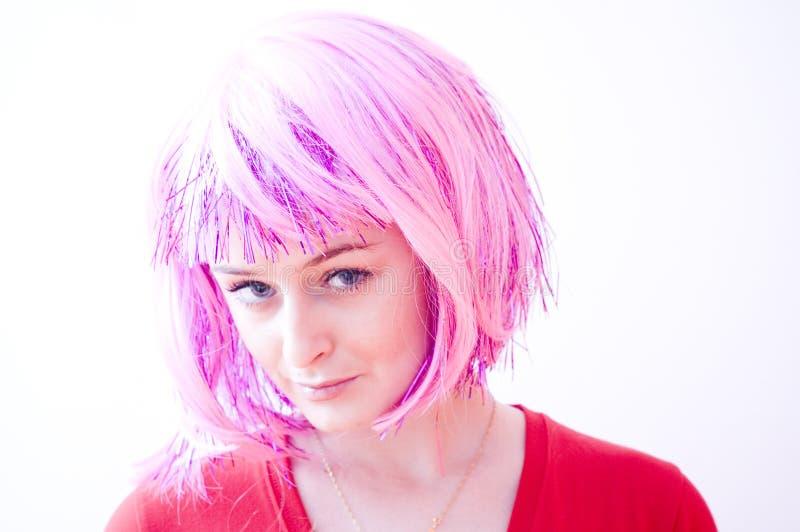 Fille d'une chevelure rose photos stock