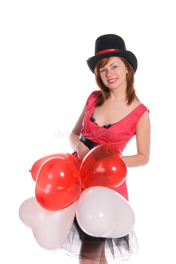 Fille d'une chevelure rouge dans le chapeau rose de robe et de cylindre photos libres de droits
