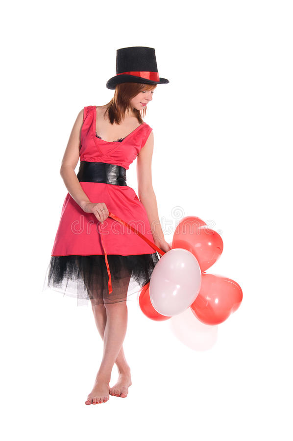 Fille d'une chevelure rouge dans le chapeau rose de robe et de cylindre image libre de droits