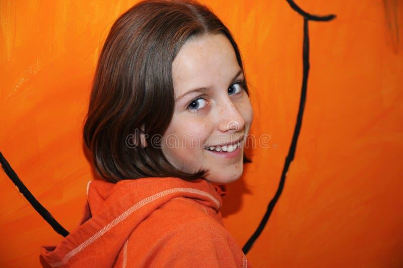Fille dans l'orange photographie stock