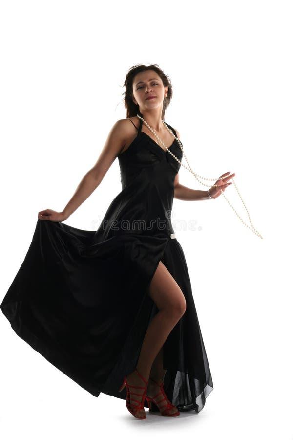Fille dans la robe noire photographie stock libre de droits