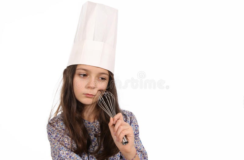 Fille dans le chapeau d'un chef photos stock