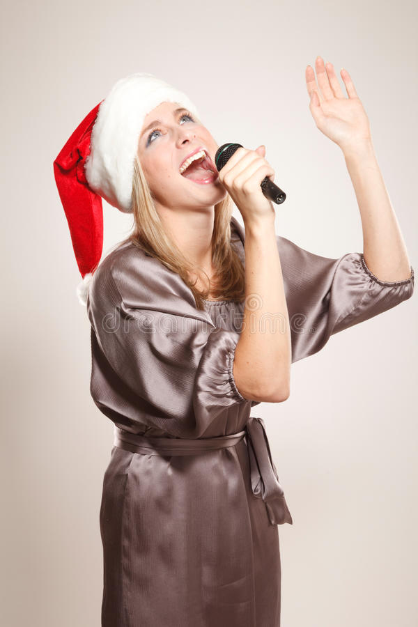Fille dans le chapeau de Santa photos stock