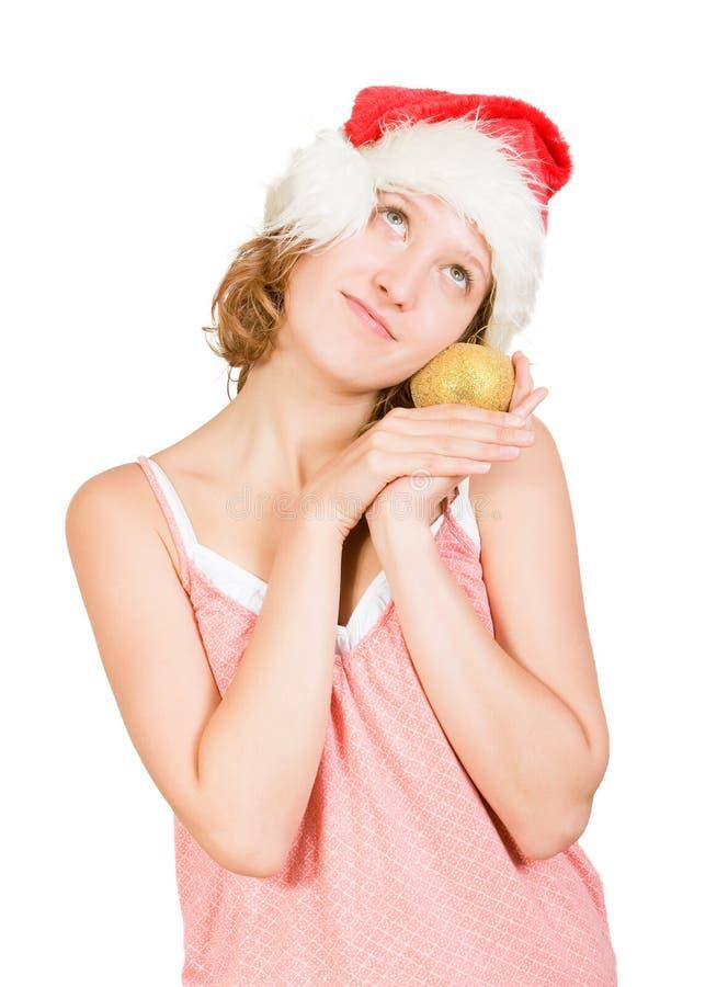Fille dans un capuchon du père noël avec la pomme d'or image libre de droits