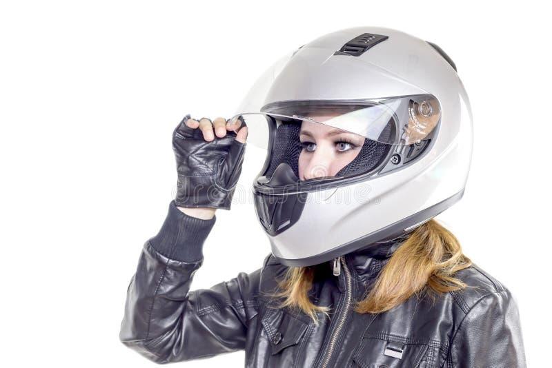 Fille dans un casque de moto image stock