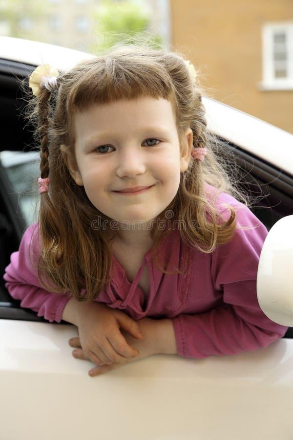 Fille dans un véhicule photographie stock