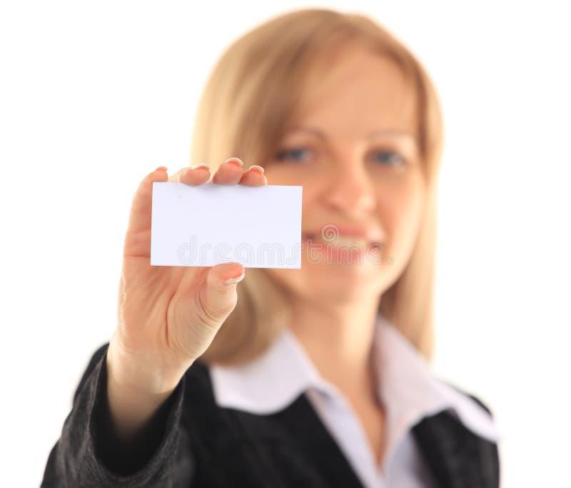 Fille dans une carte de visite professionnelle de visite - d'isolement au-dessus d'un fond blanc photo libre de droits
