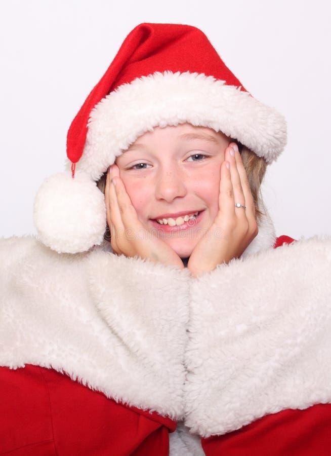 Fille de bonheur dans le capot de Noël photographie stock libre de droits