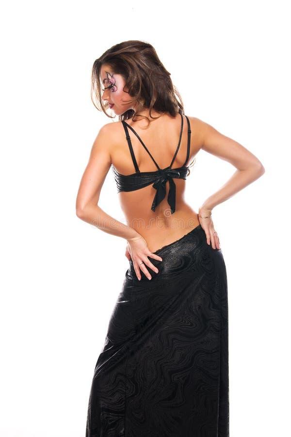 Fille de brunette de danse avec le dos et le visage sexy photographie stock libre de droits
