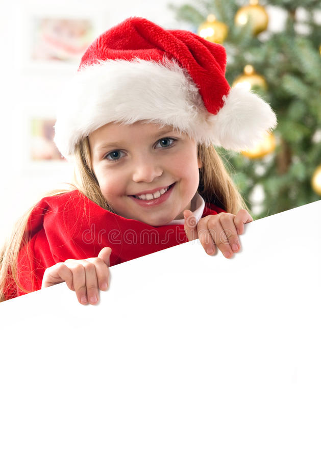Fille de cheveu assez blond avec le chapeau de Santa images stock