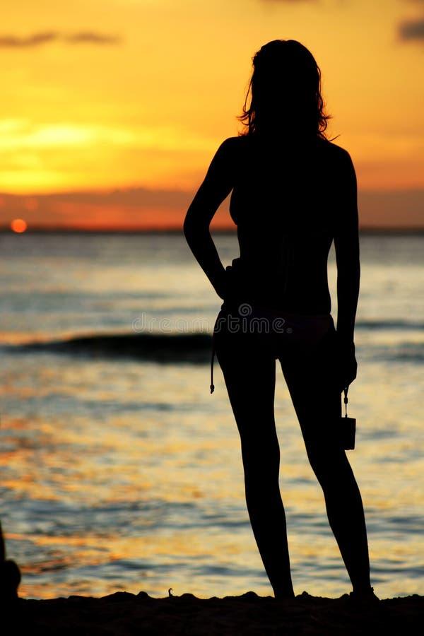 Fille de coucher du soleil images libres de droits