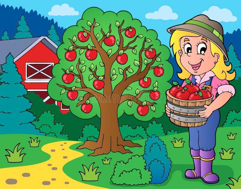 Fille de ferme avec les pommes rassemblées