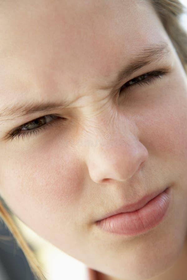 fille de froncement de sourcils d'adolescent photo libre de droits