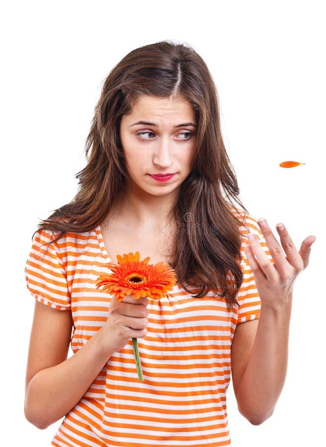 Fille de l'adolescence avec la fleur photographie stock