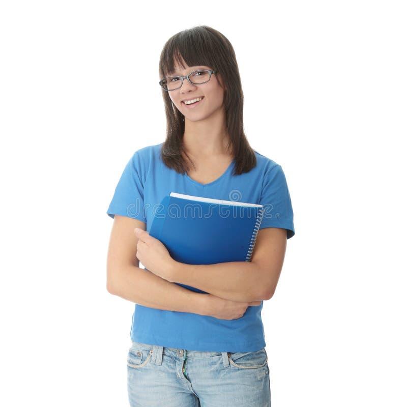 Fille de l'adolescence d'étudiant avec le bloc - notes photo stock