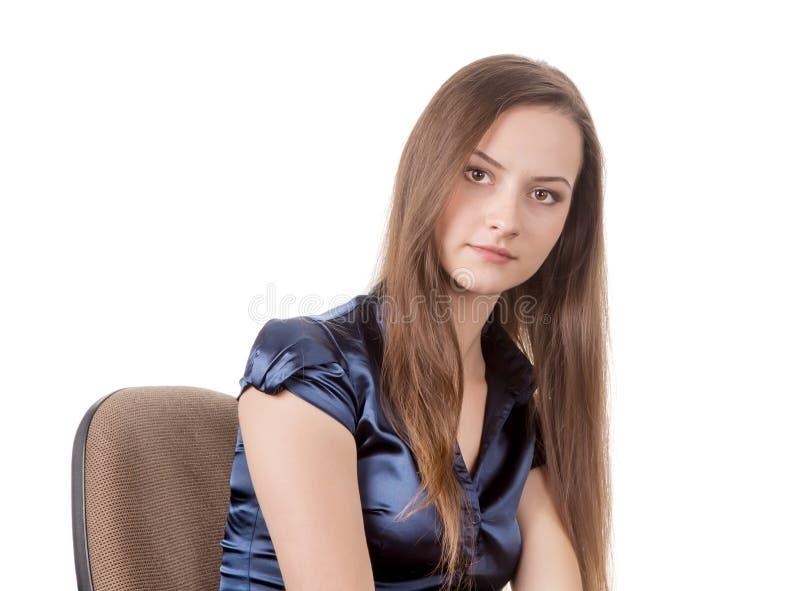 Fille de l'adolescence sur la chaise photos libres de droits